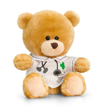 Aranyos doktor ruhás kismackó.