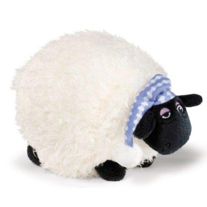 Kedves kövér bárány plüssfigura alvó sapkában.
